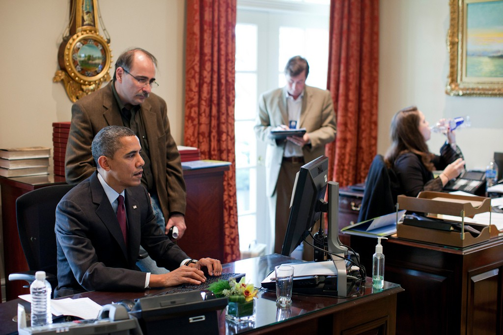 President Barack Obama and Senior Advisor David Axelrod work on a statement regarding the U.S.-Korea Trade Agreement in the Outer Oval Office, Dec. 4, 2010. At right are Terry Szuplat and Katie Johnson.  (Official White House Photo by Pete Souza)This official White House photograph is being made available only for publication by news organizations and/or for personal use printing by the subject(s) of the photograph. The photograph may not be manipulated in any way and may not be used in commercial or political materials, advertisements, emails, products, promotions that in any way suggests approval or endorsement of the President, the First Family, or the White House.